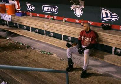 Jose Vizcaino sits alone in dugout after 5-2 loss to Cardinals in Game 7 of the NLCS